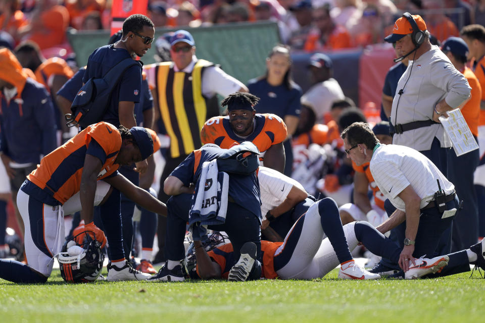Denver Broncos wide receiver K.J. Hamler is helped after an injury against the New York Jets during the first half of an NFL football game, Sunday, Sept. 26, 2021, in Denver. (AP Photo/David Zalubowski)