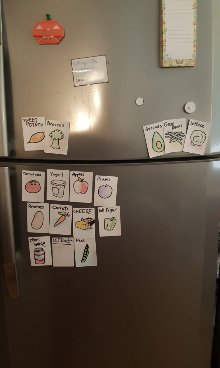 Photo shows a fridge with labels for fruit and vegetables.