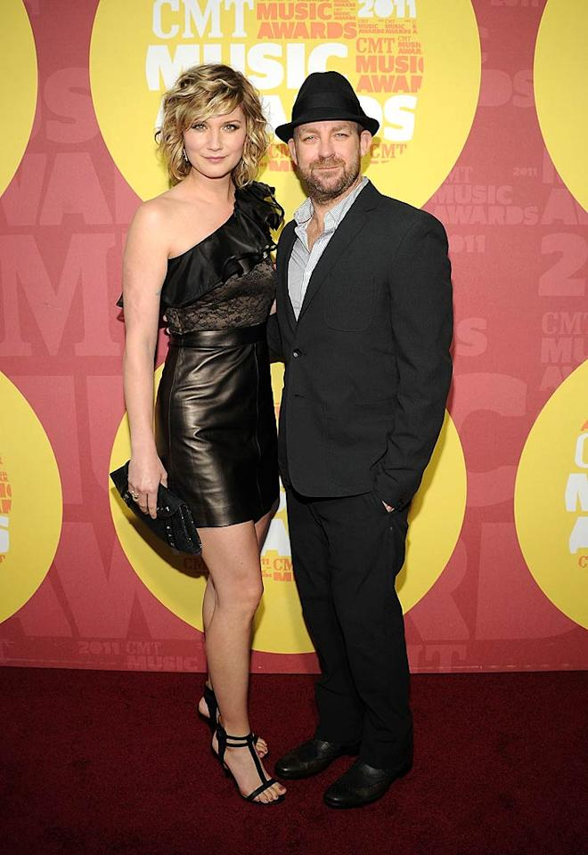 "Jennifer Nettles looked stellar in leather and lace, while her Sugarland sidekick, Kristian Bush, kept it simple in a black suit. Rick Diamond/<a href=""http://www.gettyimages.com/"" target=""new"">GettyImages.com</a> - June 8, 2011"