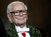 FILE - In this Nov. 30, 2016, file photo, French fashion designer Pierre Cardin acknowledges applause after a show to mark 70 years of his creations, in Paris. France's Academy of Fine Arts says famed fashion designer Pierre Cardin has died at 98. (AP Photo/Christophe Ena, File)