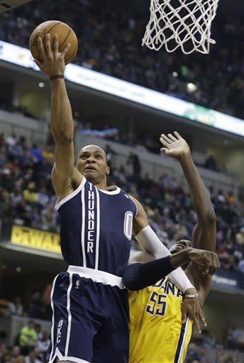 Oklahoma City Thunder's Russell Westbrook , left, shoots against Indiana Pacers' Roy Hibbert during the first half of an NBA basketball game on Friday, April 5, 2013, in Indianapolis. (AP Photo/Darron Cummings)