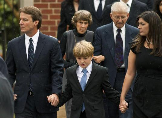 Former Democratic vice presidential nominee John Edwards, his children Jack (C) and Cate (R) leave the church after the funeral for Elizabeth Edwards in Raleigh, North Carolina December 11, 2010.