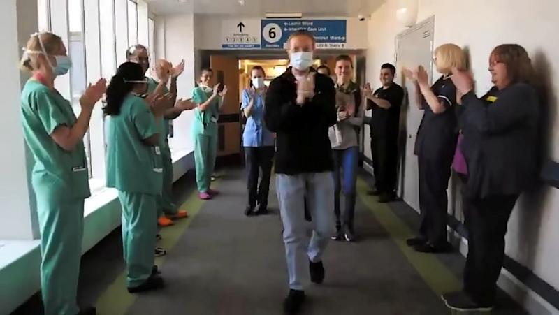 NHS worker, Paul Skegg, walking out of ICU. (SWNS)