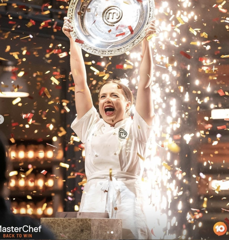 Emilia Jackson lifting up the MasterChef trophy