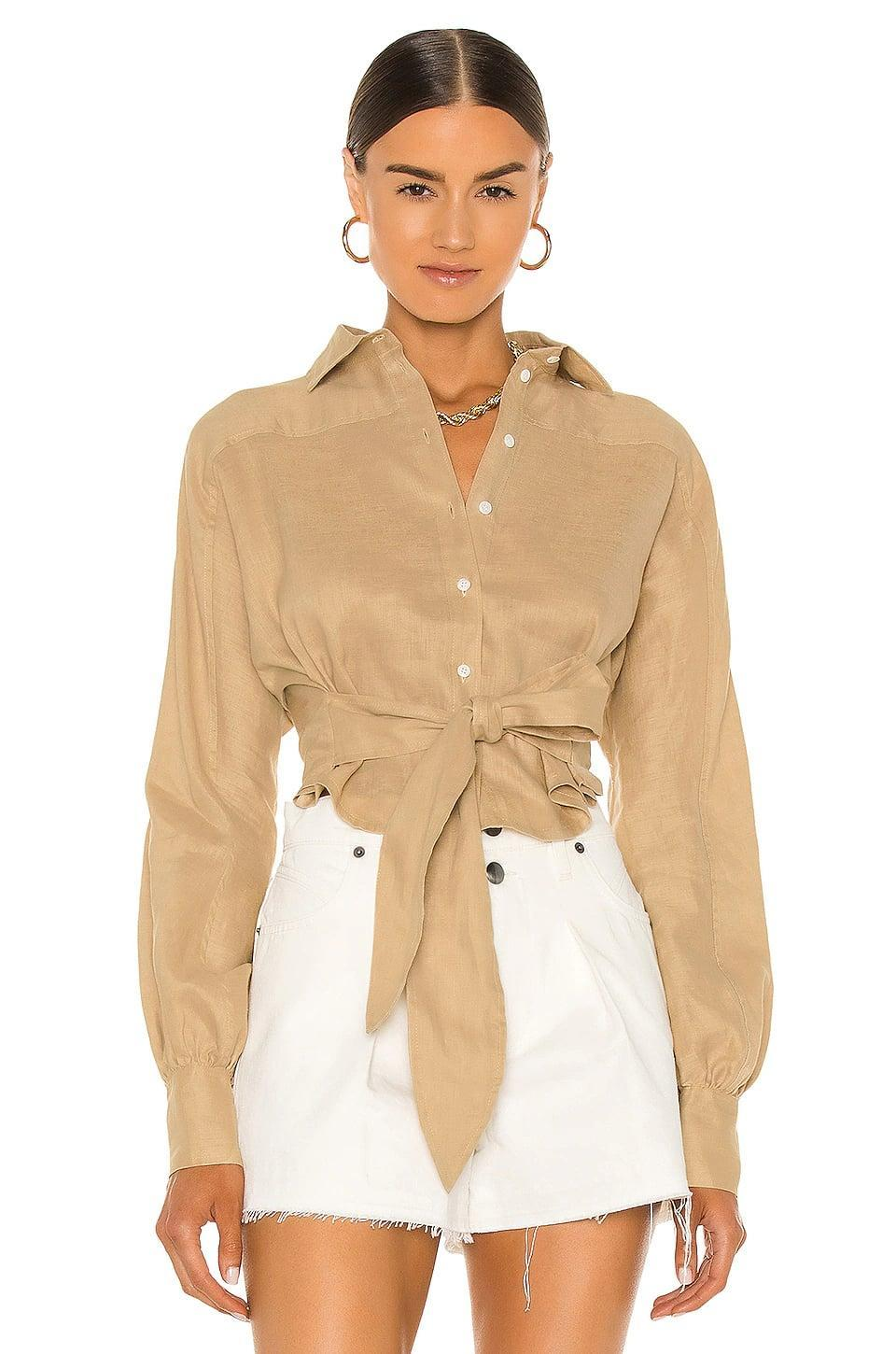 <p>This neutral <span>Marissa Webb Emmerson Linen Shirt</span> ($345) goes with everything.</p>