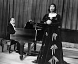 """<p>Though she's considered one of the <a href=""""https://aaregistry.org/story/a-contralto-with-strength-and-style-marian-anderson/"""" rel=""""nofollow noopener"""" target=""""_blank"""" data-ylk=""""slk:greatest contralto singers"""" class=""""link rapid-noclick-resp"""">greatest contralto singers</a> in the world, Anderson was often denied the opportunity to show off her unique vocal range because of her race. However, things started to change in 1957, when she went on a 12-nation tour sponsored by the Department of State and the American National Theatre and Academy. She documented the experience in her autobiography, <em><a href=""""https://www.amazon.com/My-Lord-What-Morning-AUTOBIOGRAPHY/dp/0252070534/?tag=syn-yahoo-20&ascsubtag=%5Bartid%7C10063.g.35405218%5Bsrc%7Cyahoo-us"""" rel=""""nofollow noopener"""" target=""""_blank"""" data-ylk=""""slk:My Lord What a Morning"""" class=""""link rapid-noclick-resp"""">My Lord What a Morning</a></em>. In 1963, she was awarded the Presidential Medal of Freedom. Her last major accomplishment before her death was receiving the Lifetime Achievement Award at the Grammy's in 1991.</p>"""