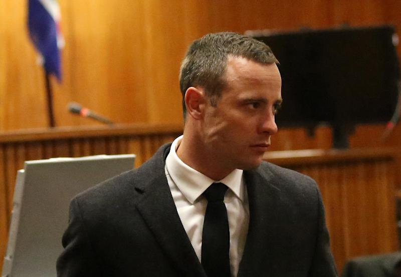 Olympic track star Oscar Pistorius is pictured during his murder trial at the North Gauteng High Court in Pretoria on May 20, 2014 (AFP Photo/Siphiwe Sibeko)