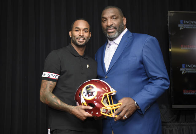 Newly signed Washington Redskins wide receiver Paul Richardson, left, poses with Doug Williams, right, the NFL football team's senior vice president of player personnel, at a news conference Thursday, March 15, 2018, in Ashburn, Va. (AP Photo/Nick Wass)