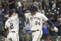 Milwaukee Brewers' Avisail Garcia is congratulated by Luis Urias after hitting a two-run home run during the eighth inning of a baseball game against the St. Louis Cardinals Wednesday, May 12, 2021, in Milwaukee. (AP Photo/Morry Gash)