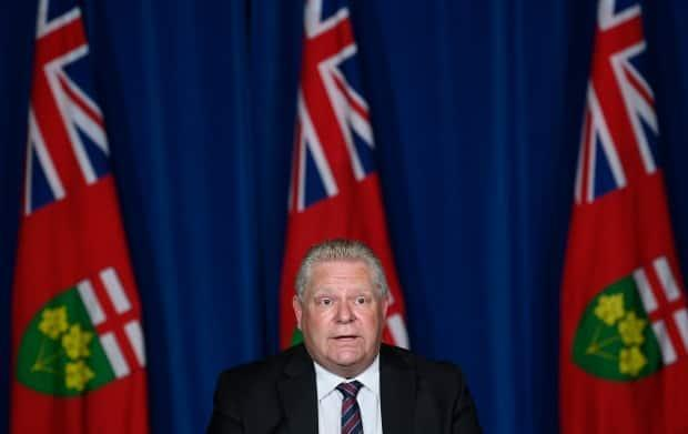 Ontario Premier Doug Ford holds a news conference at Queen's Park in Toronto on May 20, 2021, outlining a plan by the province to reopen after weeks of lockdown. (Nathan Denette / Canadian Press - image credit)