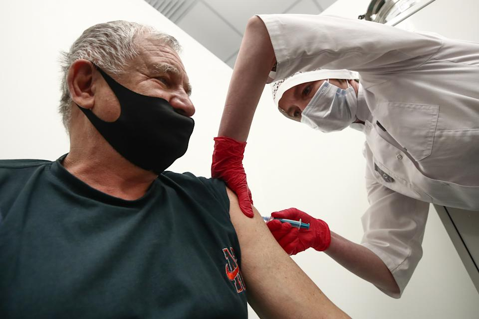 MOSCOW, RUSSIA  APRIL 21, 2021: A man receives an injection of the Gam-COVID-Vac (Sputnik V) vaccine at a temporary COVID-19 vaccination site set up at the TsUM Central Department Store. Valery Sharifulin/TASS (Photo by Valery Sharifulin\TASS via Getty Images)