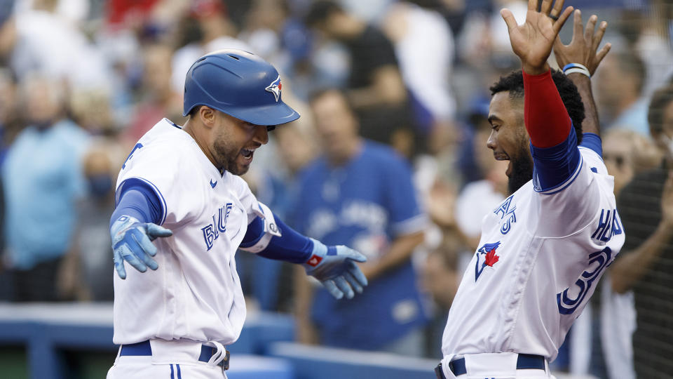 George Springer #4 of the Toronto Blue Jays and Teoscar Hernandez #37 celebrate Springer's home run. (Photo by Cole Burston/Getty Images)