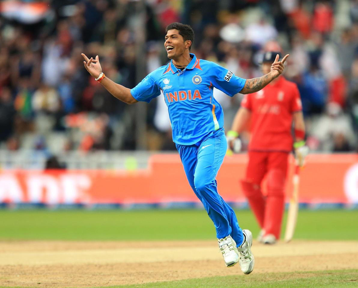 India's Umesh Yadav celebrates the wicket of England's Alastair Cook during the ICC Champions Trophy Final at Edgbaston, Birmingham.