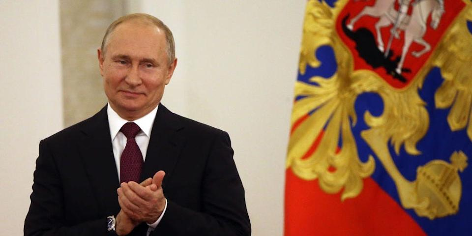 Russian President Vladimir Putin applauds during the State Awards Ceremony at the Grand Kremlin Palace in Moscow, Russia.