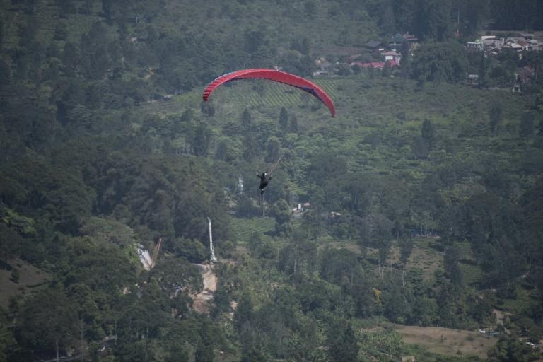 The Asian Games paragliding competition is being held in countryside near Jakarta