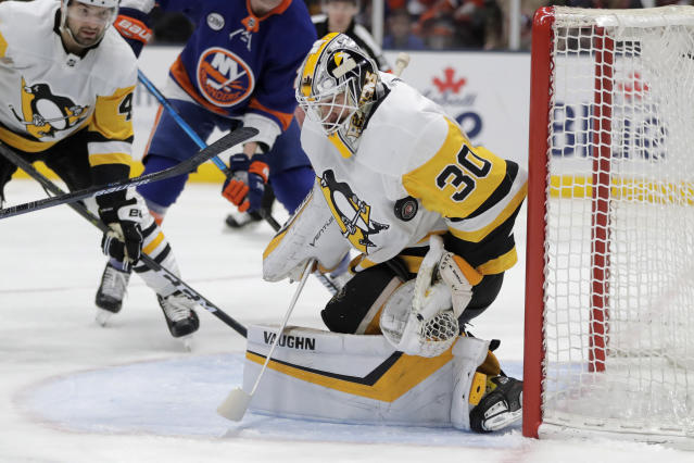 Pittsburgh Penguins goaltender Matt Murray blocks a shot from the New York Islanders during the second period of Game 2 of an NHL hockey first-round playoff series Friday, April 12, 2019, in Uniondale, N.Y. (AP Photo/Julio Cortez)