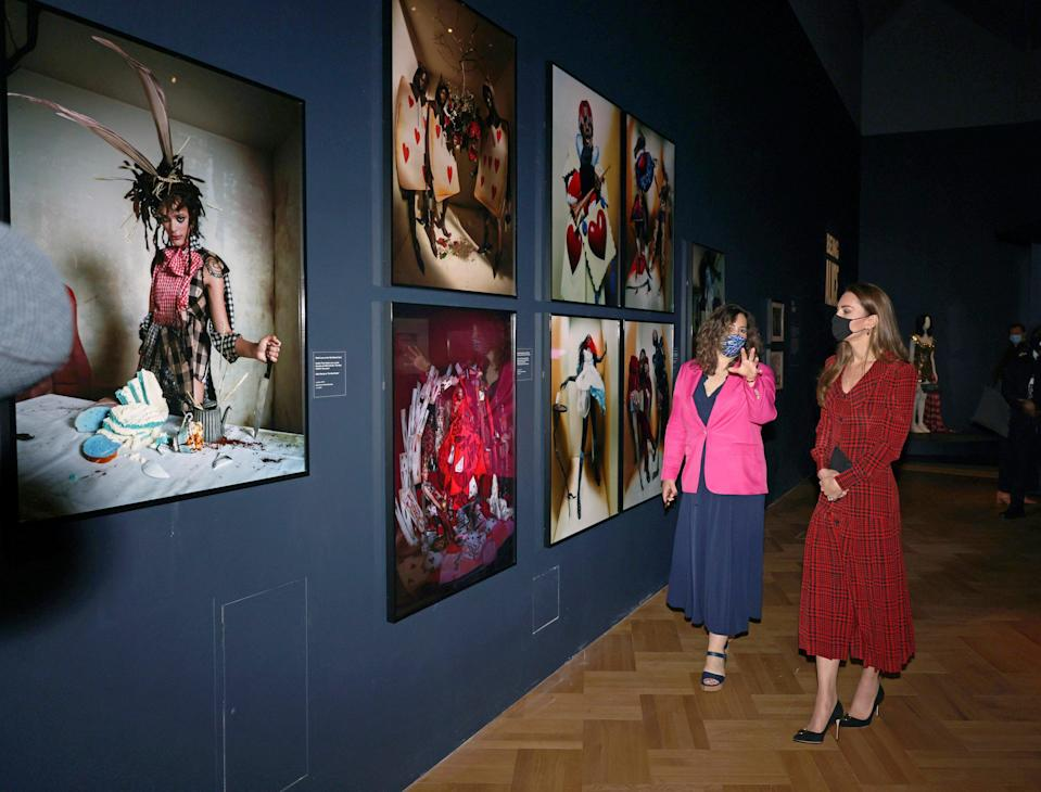 The duchess views the Alice exhibition with curator Kate BaileyAP