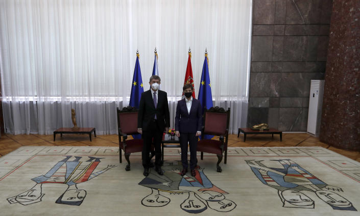 Czech Prime Minister Andrej Babis, left, poses with his Serbian counterpart Ana Brnabic ahead of their talks at the Serbia Palace in Belgrade, Serbia, Wednesday, Feb. 10, 2021. Babis is on a one-day official visit to Serbia. (AP Photo/Darko Vojinovic)