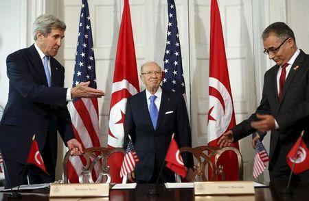 U.S. Secretary of State John Kerry and Tunisian President Beji Caid Essebsi with Minister for Political Affairs Mohsen Marzouk arrive to sign a memorandum of understanding in Washington