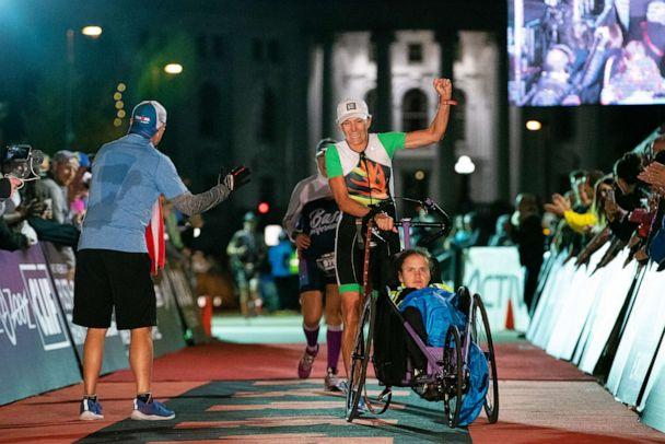 PHOTO: Beth James and Liza James finish the IRONMAN Wisconsin, Sept. 9, 2018, in Madison, Wisconsin. (Patrick McDermott/Getty Images for IRONMAN)