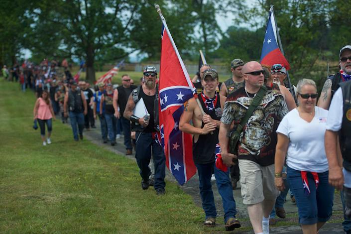 Activists holding Confederate flags gather at the Gettysburg National Military Park on July 1, 2017, in Gettysburg, Pennsylvania. The U.S. park service issued protest permits for three groups, including Sons of Confederate Veterans, on the 154th anniversary of the battle. (Photo: Mark Makela via Getty Images)