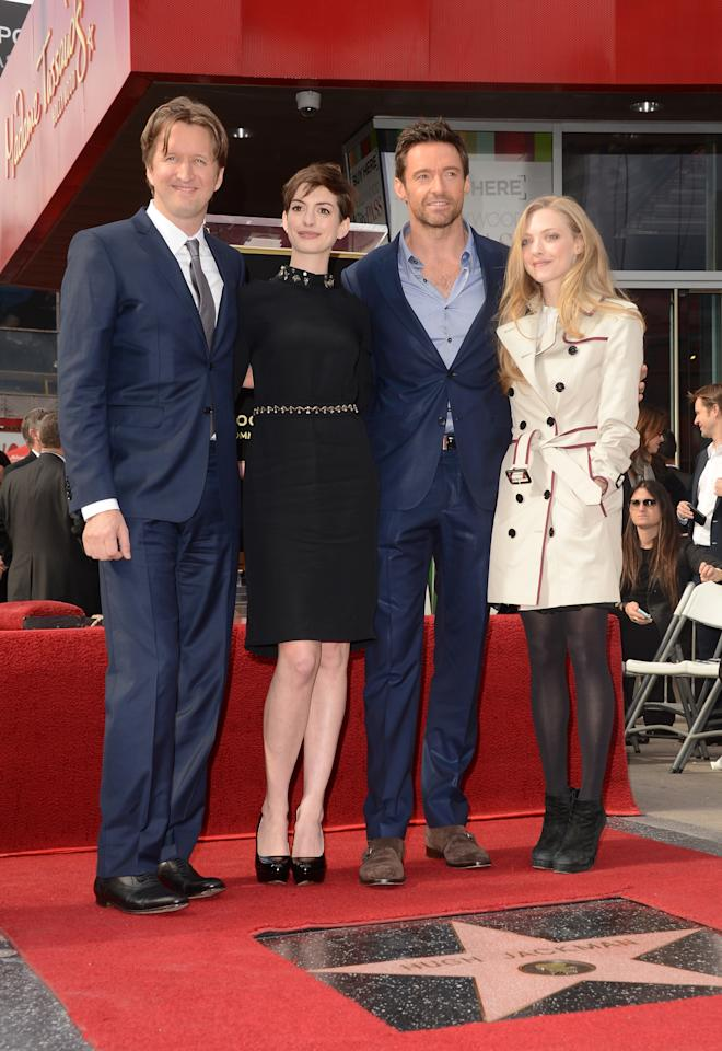 HOLLYWOOD, CA - DECEMBER 13:  Director Tom Hooper poses with actors Anne Hathaway, Hugh Jackman, and Amanda Seyfried at the Hugh Jackman Hollywood Walk Of Fame ceremony on December 13, 2012 in Hollywood, California.  (Photo by Jason Merritt/Getty Images)