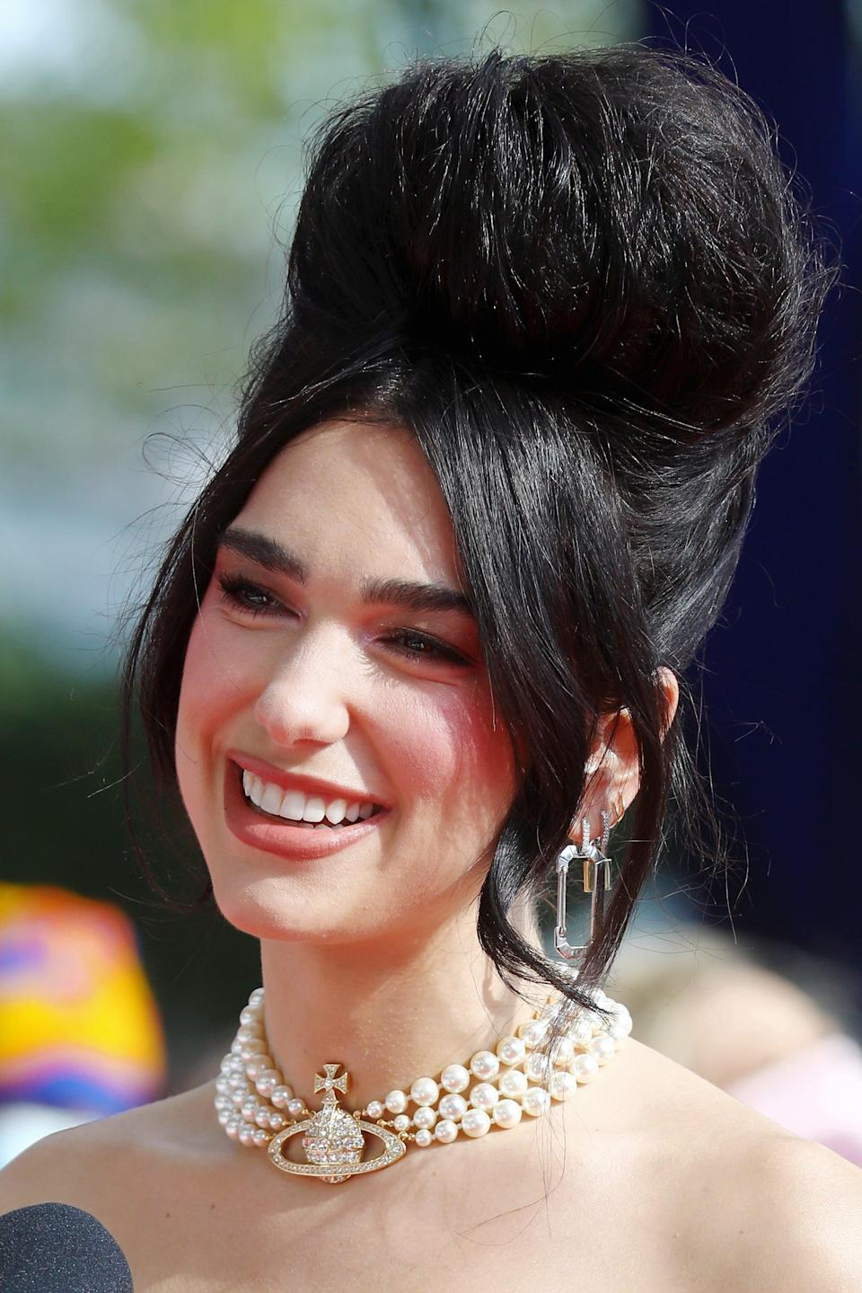 """<p>From Dua Lipa to Anya Taylor Joy to Andra Day, it looks like the bouffant hairstyle is here to stay as the next throwback hair trend making a comeback. The reason is simple: """"It's drama, and while it can definitely be over the top, it can be very underplayed as well,"""" hairstylist <a href=""""https://www.instagram.com/sammcknight1/?hl=en"""" class=""""link rapid-noclick-resp"""" rel=""""nofollow noopener"""" target=""""_blank"""" data-ylk=""""slk:Sam McKnight"""">Sam McKnight</a> told POPSUGAR. """"Plus, a bit of height always makes people feel a bit taller, and a bit grander, and a bit more done if you like. And I think the best way to do them, the modern way to do them, is to have it kind of really undone and have it not look too perfect."""" </p>"""