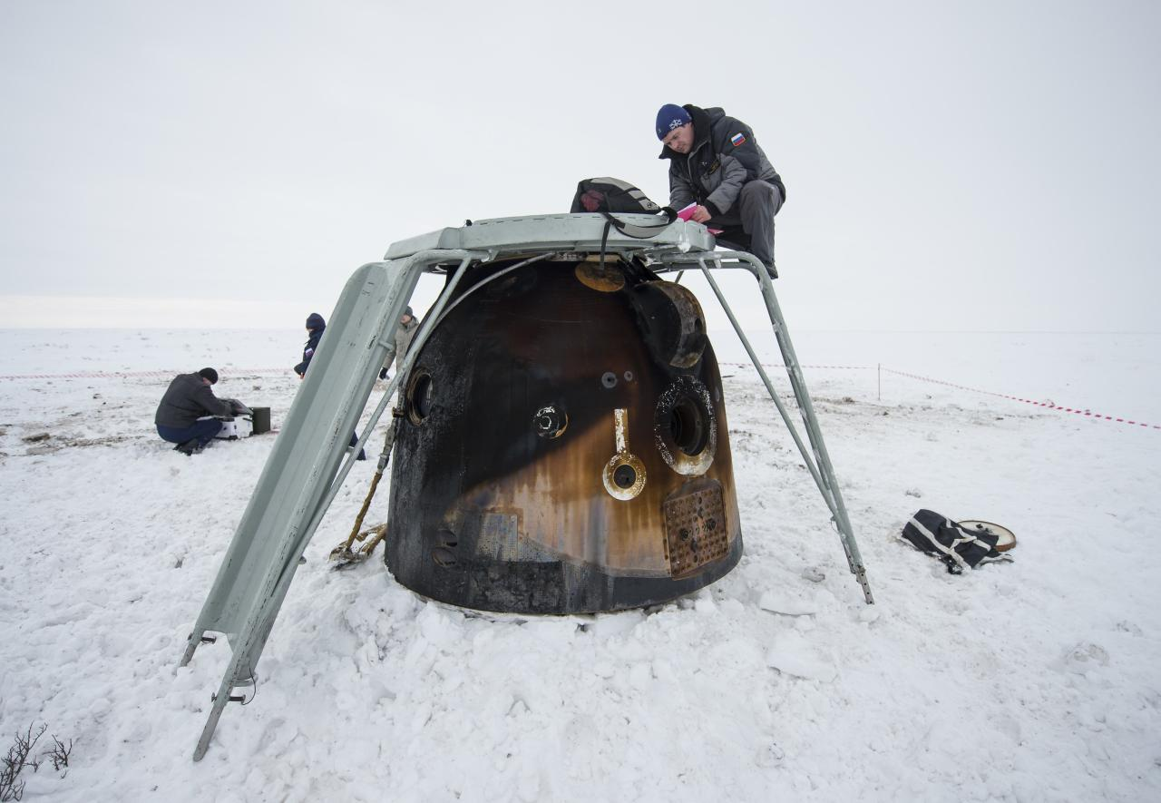 Engineers document cargo as it is unloaded from the Soyuz TMA-10M spacecraft after it landed with former ISS commander Oleg Kotov and flight engineers Sergei Ryazansky and Michael Hopkins from NASA onboard in a remote area southeast of the town of Zhezkazgan in central Kazakhstan, March 11, 2014. An American astronaut and two Russians who carried a Sochi Olympic torch into open space landed safely and on time on Tuesday in Kazakhstan, defying bad weather and ending their 166-day mission aboard the International Space Station (ISS). Inside the capsule were former ISS commander Oleg Kotov and flight engineers Sergei Ryazansky and Michael Hopkins from NASA. The trio launched together into space on September 25. REUTERS/Bill Ingalls/NASA/Handout via Reuters (KAZAKHSTAN - Tags: TRANSPORT SCIENCE TECHNOLOGY) 