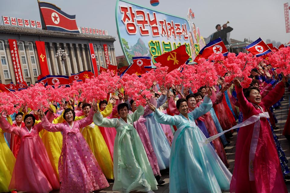 Women wearing traditional clothes react as they march past the stand with North Korean leader Kim Jong-un during a military parade marking the 105th birth anniversary of the country's founding father, Kim Il-sung in Pyongyang: Damir Sagolj/Reuters