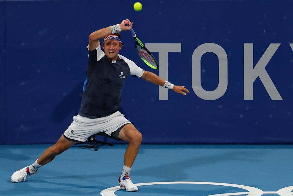 Tennys Sandgren hits a forehand against Pablo Carreno Busta of Spain in a first-round men's singles match.