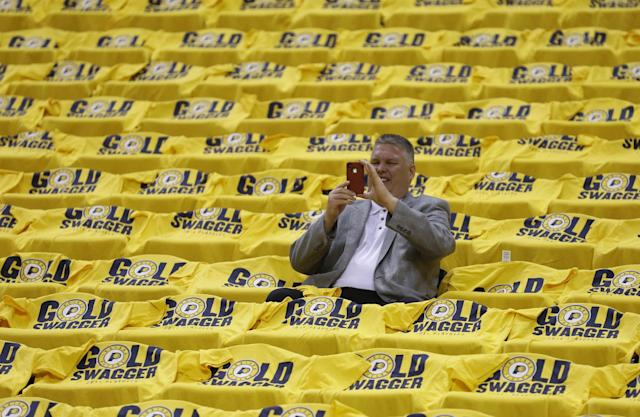 A fan takes a photo before game 1 of the Eastern Conference semifinal NBA basketball playoff series between the Indiana Pacers and the Washington Wizards in Indianapolis, Monday, May 5, 2014(AP Photo/Michael Conroy)