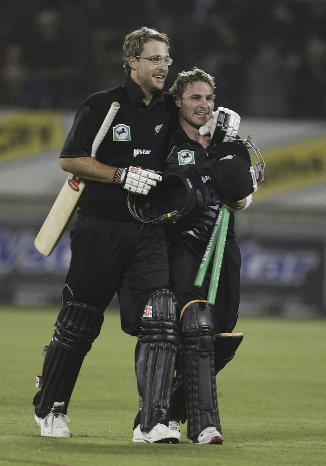 CHRISTCHURCH, NEW ZEALAND - DECEMBER 10:  Daniel Vettori (L) and Brendon McCullum (R) of New Zealand walk off the pitch celebrating after their victory over Australia in the third Chappell-Hadlee Trophy one day international between New Zealand and Australia played at Jade Stadium December 10, 2005 in Christchurch, New Zealand  (Photo by Phil Walter/Getty Images)