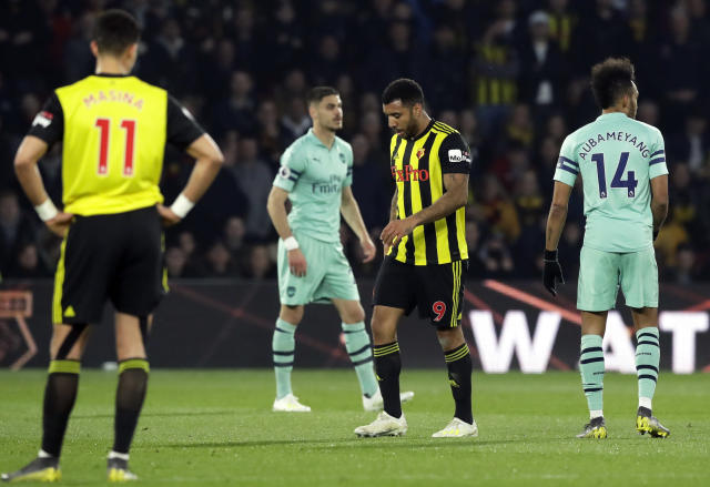 Watford's Troy Deeney, 2nd right, leaves the pitch after being shown a red card during the English Premier League soccer match between Watford and Arsenal at Vicarage Road stadium in Watford, England, Monday, April 15, 2019. (AP Photo/Matt Dunham)