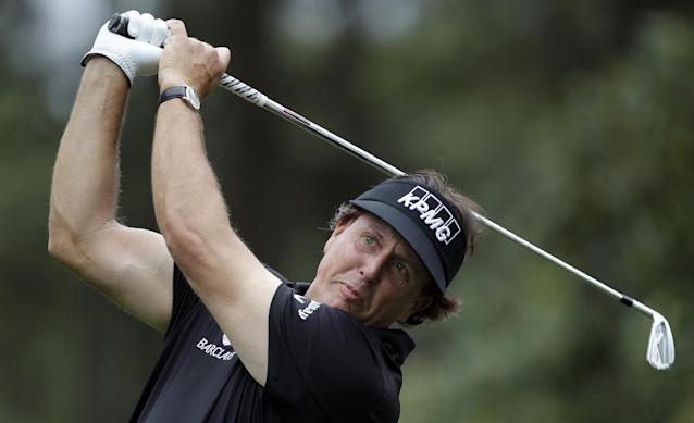 Phil Mickelson watches his tee shot travel to the sixth green during the pro-am of the Wells Fargo Championship golf tournament at Quail Hollow Club in Charlotte, N.C., Wednesday, April 30, 2014. (AP Photo/Bob Leverone)