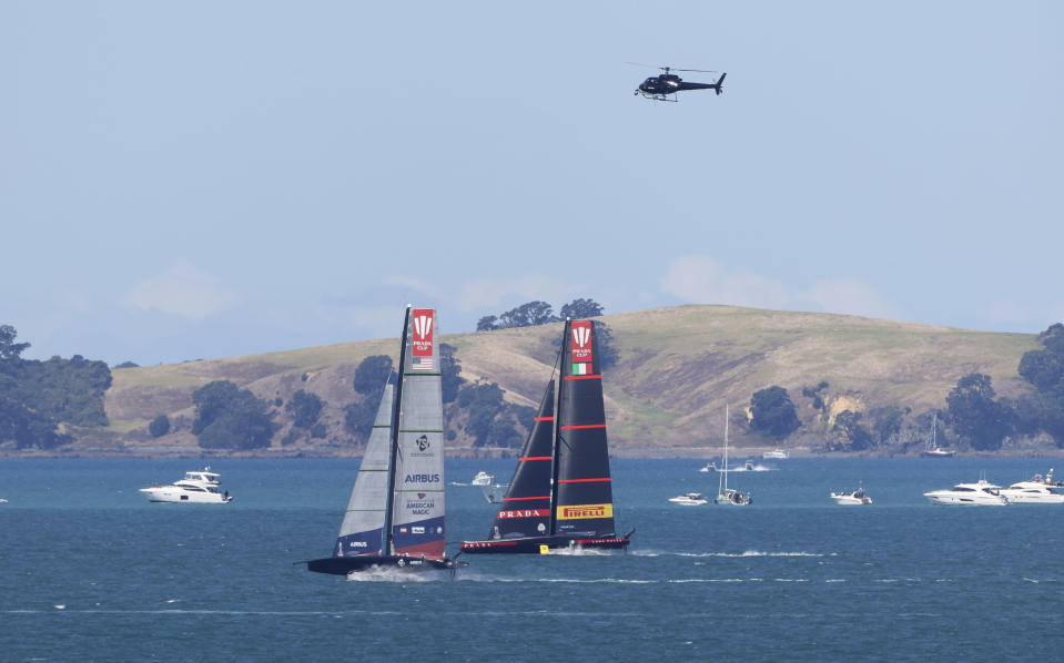 American Magic, left, and Italy's Luna Rossa race in the America's Cup challenger series semifinals on Auckland's Waitemate Harbour, New Zealand, Saturday, Jan. 30, 2021. (Brett Phibbs/NZ Herald via AP)