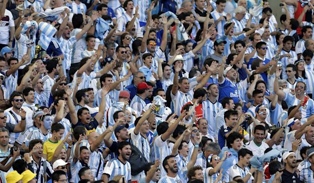 Argentina fans cheer prior to the World Cup final soccer match between Germany and Argentina at the Maracana Stadium in Rio de Janeiro, Brazil, Sunday, July 13, 2014. (AP Photo/Victor R. Caivano)