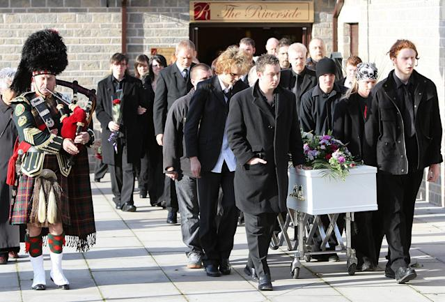 Mourners walk alongside the coffin of Sophie Lancaster at her funeral in Whitworth, Lancashire (PA)
