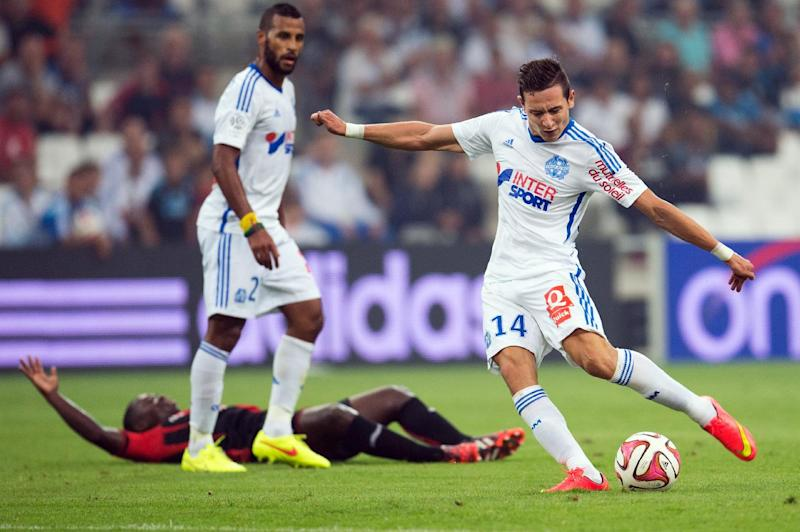 Marseille's French midfielder Florian Thauvin prepares to kick the ball during the French L1 football match Olympique de Marseille vs OGC Nice on August 29, 2014 at the Velodrome stadium in Marseille