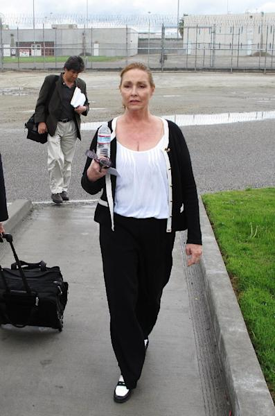 In this Wednesday, April 11, 2012 photo, Debra Tate, younger sister of murdered actress Sharon Tate, leaves Corcoran State Prison in Corcoran, Calif., after she testified at a parole hearing for Charles Manson. The panel denied parole for mass murderer Manson, 77, in his 12th and possibly final bid for freedom. Tate and Barbara Hoyt, the Manson family member whose testimony helped put the killers in prison, have bonded in their long quest to keep those responsible for the murders behind bars. (AP Photo/Tracie Cone)