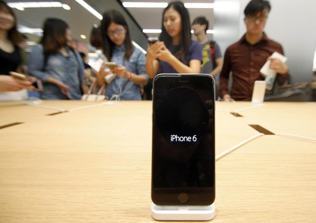 "Apple has blamed ""external physical damage"" for causing a handful of iPhones to explode or catch fire in China (AFP Photo/STR)"