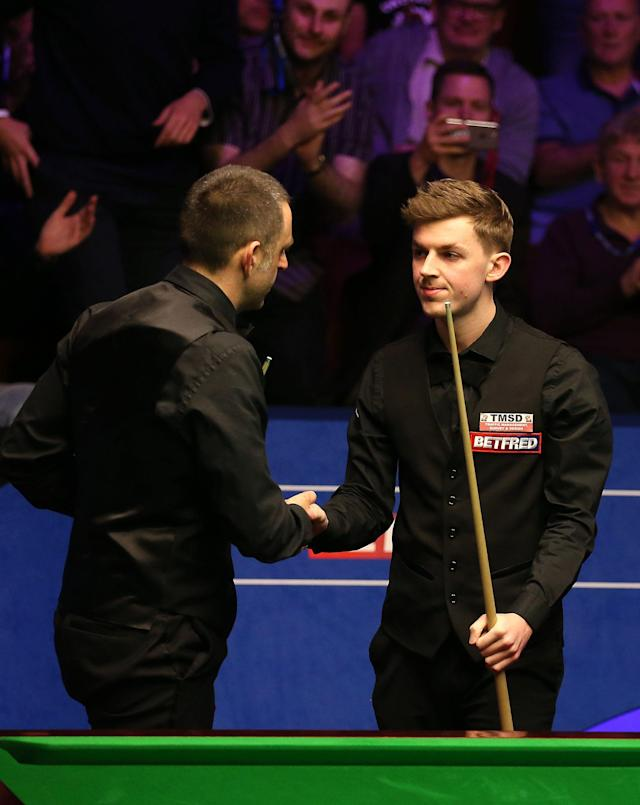 James Cahill is congratulated by Ronnie O'Sullivan at The Crucible, Sheffield.