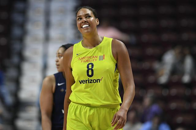 FILE - In this May 8, 2018, file photo, Dallas Wings' Liz Cambage smiles during a preseason WNBA basketball game, in Uncasville, Conn. Cambage, of Australia, scored 53 points to set a WNBA record Tuesday, July 17, 2018, leading the Dallas Wings to a 104-87 victory over the New York Liberty. (AP Photo/Jessica Hill, File)