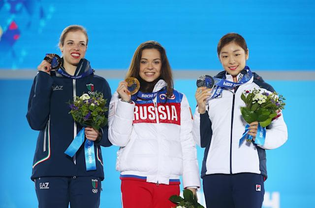 SOCHI, RUSSIA - FEBRUARY 21: (L-R) Bronze medalist Carolina Kostner of Italy, Gold medalist Adelina Sotnikova of Russia and Silver medalist Yuna Kim of South Korea celebrate during the medal ceremony for the Women's Free Figure Skating on day fourteen of the Sochi 2014 Winter Olympics at Medals Plaza on February 21, 2014 in Sochi, Russia. (Photo by Streeter Lecka/Getty Images)