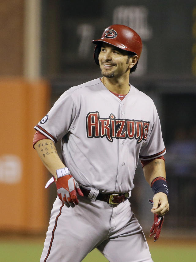 Arizona Diamondbacks' Eric Chavez smiles after hitting a single off San Francisco Giants starting pitcher Yusmeiro Petit in the ninth inning of their baseball game against the Arizona Diamondbacks Friday, Sept. 6, 2013, in San Francisco. San Francisco won the game 3-0 and Chavez had the only hit for the Diamondbacks. (AP Photo/Eric Risberg)