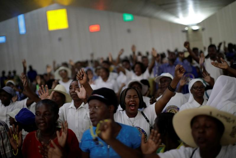 Faithful pray at Christ Roi church before a march organised by religious leaders in Port-au-Prince