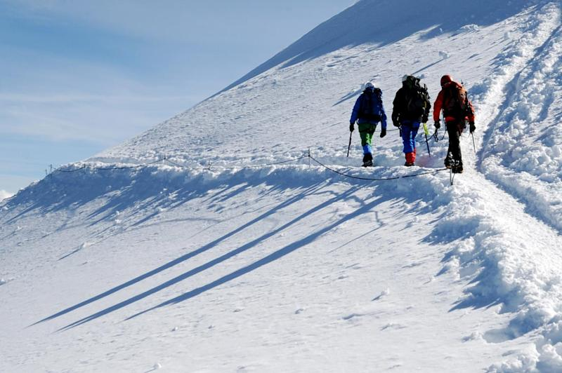 A file photo taken on July 2, 2013 in the mountains of Mont-Blanc, eastern France, shows alpinists leaving the Gouter mountain hut, at 3,835 metre (12,582 ft) (AFP Photo/Jean-Pierre Clatot)