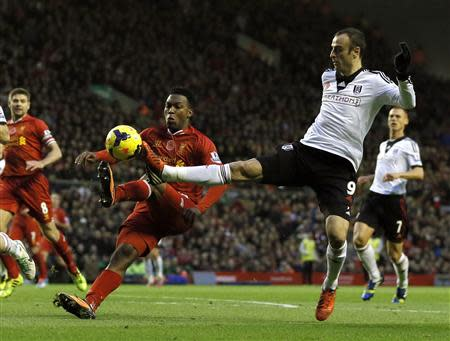 Liverpool's Sturridge challenges Fulham's Berbatov during their English Premier League soccer match at Anfield in Liverpool