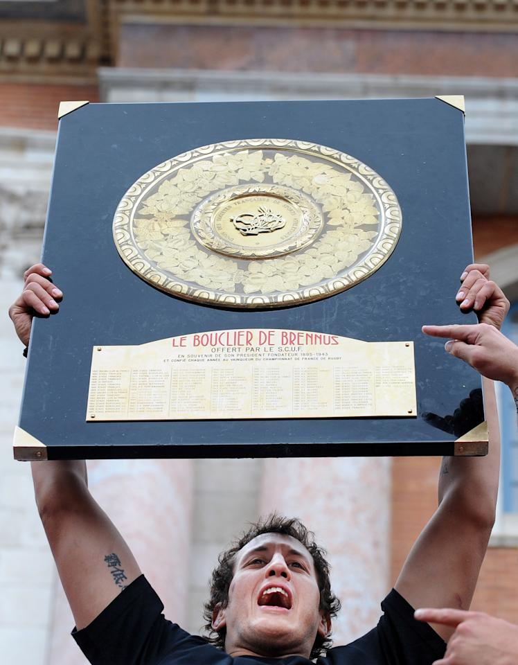 Toulouse rugby team lock Patricio Albacete holds the Brennus Shield trophy in front of supporters on June 10, 2012 on the Capitole square in the French southwestern city of Toulouse. Toulouse won 18-12 the French Top 14 rugby union final match vs Toulon, on June 9, 2011 at the Stade de France in Saint-Denis, northern Paris. AFP PHOTO / REMY GABALDAREMY GABALDA/AFP/GettyImages