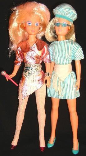 """<div class=""""caption-credit""""> Photo by: Hasbro</div><b>Original Jerrica Benton (pictured right)</b> <br> Jerrica was a career lady with a less-flashy style. Here you can see how the doll changed from Jem into Jerrica with a striped shirtdress and matching beret, aqua pumps, and sunglasses. Then you flipped the fringed belt over, to reveal a matching neutral white side. As a further disguise, you'd lift up the top pink portion of her hair and tuck it into her hat to reveal a blonde bob."""