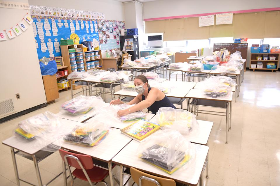 NEW YORK, NEW YORK - AUGUST 25:  Nancy Rastetter, a teacher at Yung Wing School P.S. 124, packs up belongings of students from the 2019/2020 school year on August 25, 2020 in New York City. New York City public schools are scheduled to start September 10 with new guidelines in place for how they will operate.  (Photo by Michael Loccisano/Getty Images)